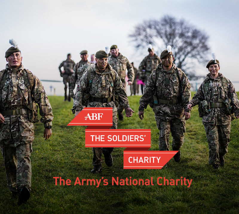 A promotional image for ABF The Soldiers charity featuring soldiers in full camouflage walking downhill.