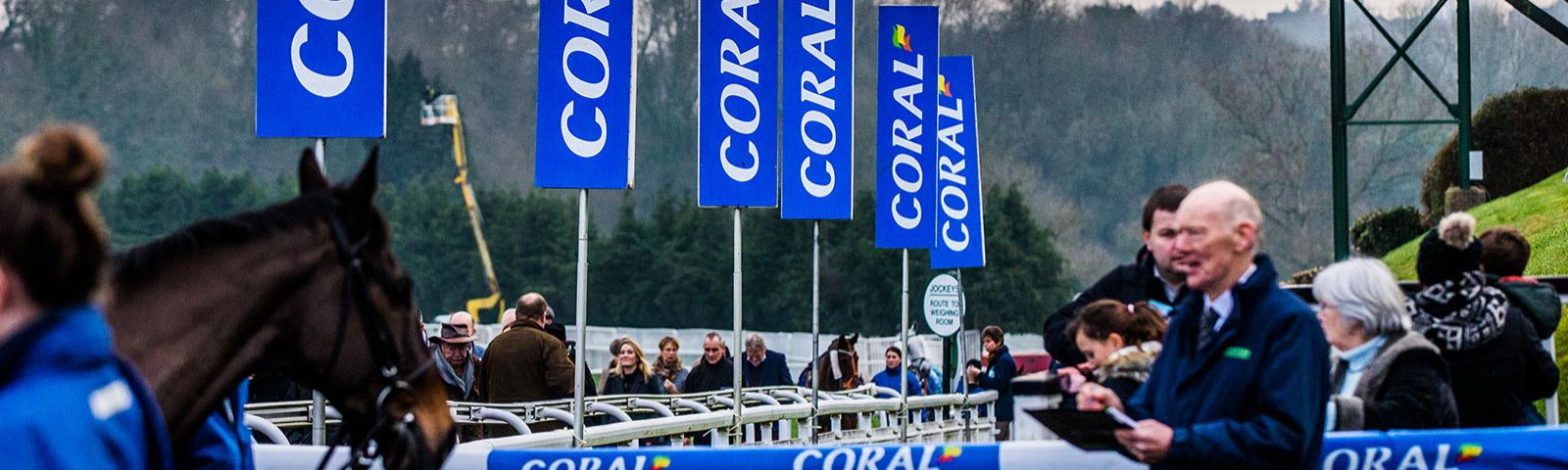 A Chepstow Racecourse sponsor's (Coral) flag is highly visible around the parade ring.