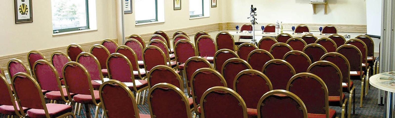 A conference room prepared awaiting the arrival of guests.