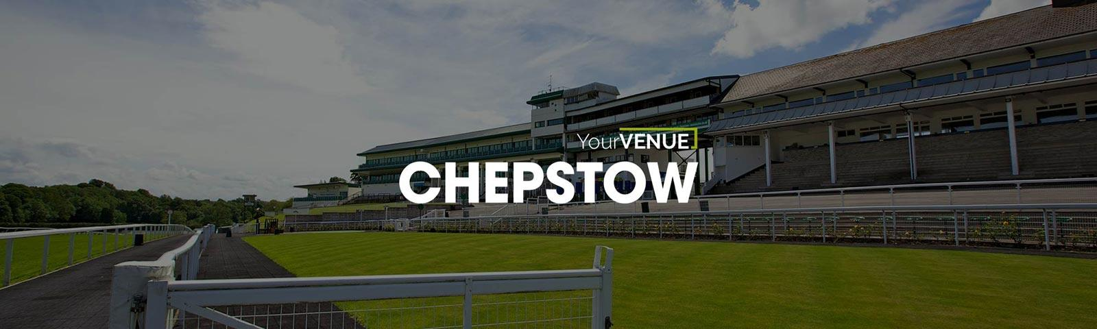 A view across the turf track looking at the grandstand at Chepstow Racecourse.