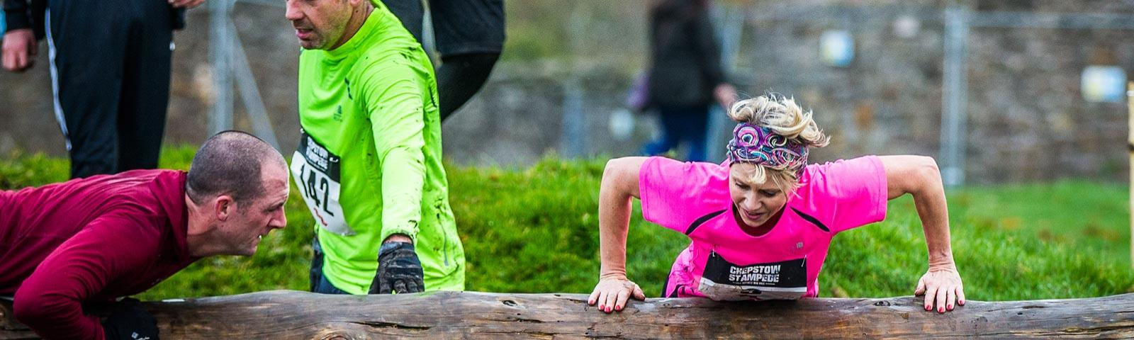 Competitors climb over one of Chepstow Stampede's obstacles.