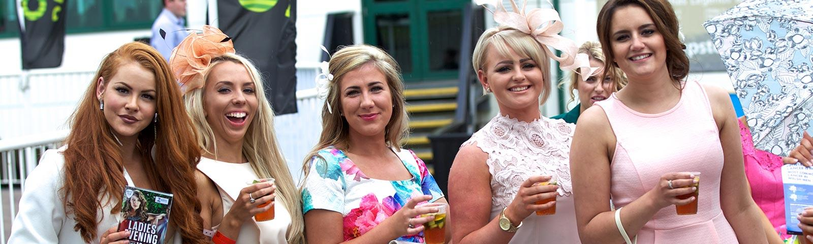 Group of ladies posing for a photo at a raceday at Chepstow Racecourse.