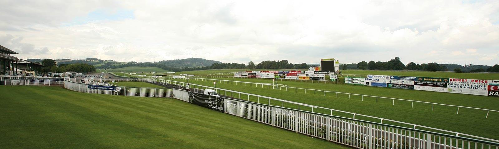 A view of the green turf track at Chepstow Racecourse.