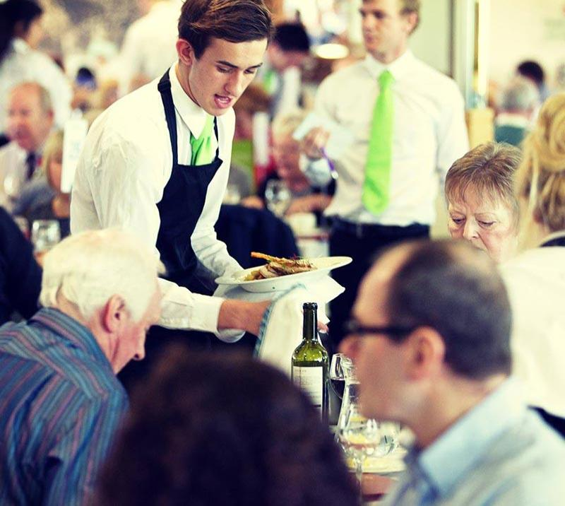 Waiting staff tend to happy customers in one of the eateries at Chepstow Racecourse.