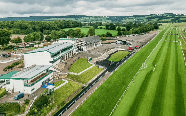 An aerial view of the grandstand and home straight at Chepstow Racecourse