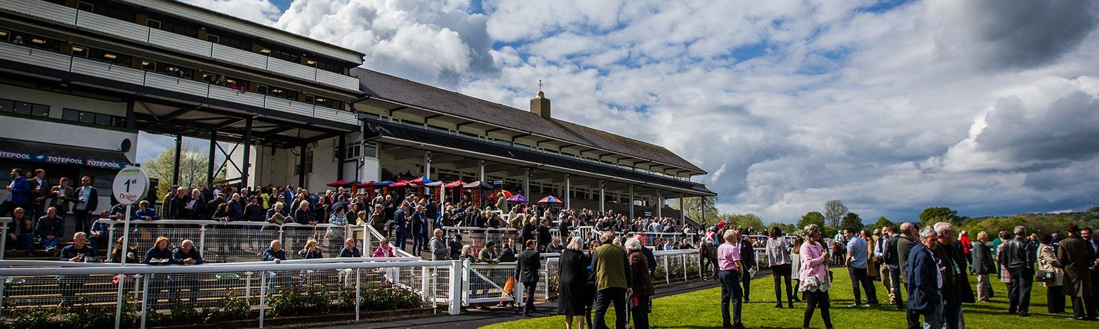 Crowds gathered around the main grandstand at Chepstow Racecourse.
